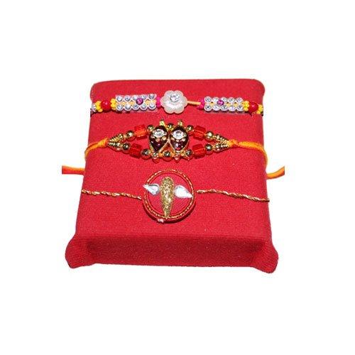 handicrunch-white-stone-3-rakhi-with-haldiram-soan-papdi
