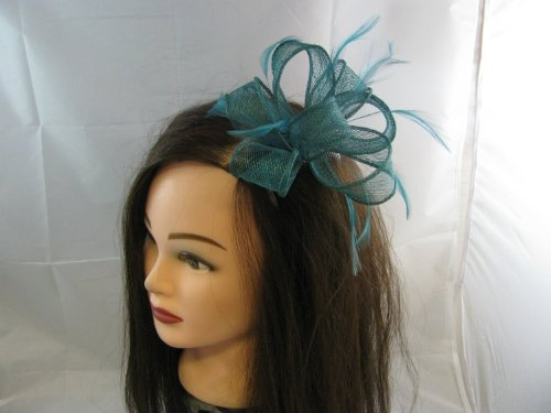 Delicate dark teal sinamay loops fascinator with feather tendrils set on clear comb. Ideal for a wedding, Ascot and any other special occasion.