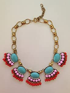 Fringe Necklace - Turquoise and Coral - Make a Statement in This Bright Bauble Bib Necklace From Brighthouse Baubles. Features Beautiful Bead Work, an Adjustable Gold Plated Chain, and a Lobster Clasp. Great Quality. Designer Inspired. Satisfaction Guaranteed.