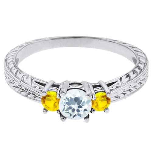 0.59 Ct Round Sky Blue Topaz Yellow Sapphire 18K White Gold 3-Stone Ring