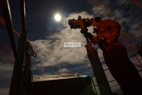 Photo Us Navy (Usn) Seaman (Sn) Jason Vargo Uses The Big-Eye Binoculars As He Stands An Evening Lookout Watch On The Signal Bridge Of The Usn Nimitz Class: Aircraft Carrier Uss John C. Setnnis (Cvn 74) While The Ship Is Underway Conducting Carrier Qualifi
