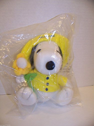 peanuts-metlife-plush-65-snoopy-in-yellow-rain-jacket-and-hat-holding-a-yellow-flower-by-peanuts