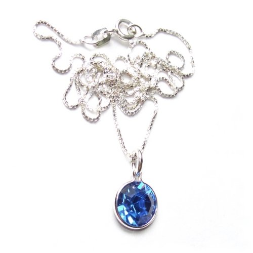Sparkling pendant. Made with a single Sapphire Blue Swarovski crystal stone. Set on a Sterling silver chain. Gift box. Made in England. Beautiful jewellery for very special people.