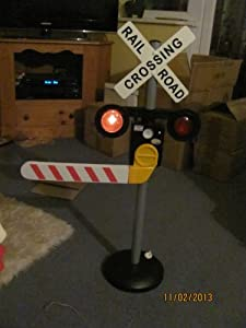 Railroad crossing. Talks in 3 languages. Flashing lights ...