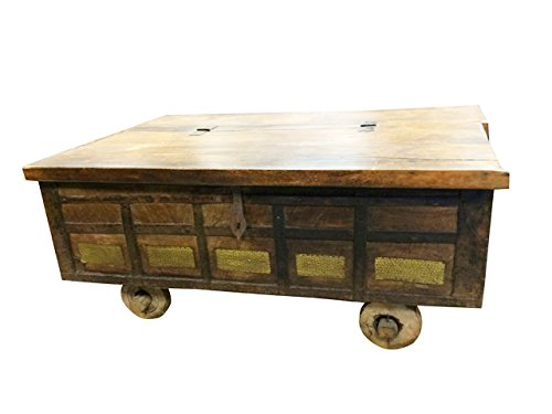 Antique trunk chest on wheels coffee table brass cladded Antique wheels for coffee table
