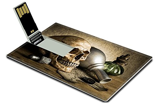 Luxlady 16GB USB Flash Drive 2.0 Memory Stick Credit Card Size IMAGE ID: 25518354 Still life human skull with knife