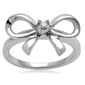 simple silver bow ring with Sterling Silver and Diamond n the center of thee bow