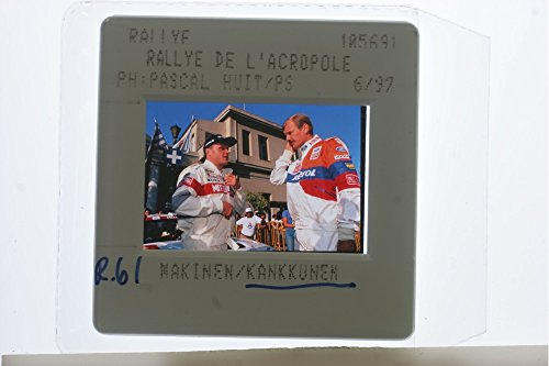 slides-photo-of-makinen-and-kankkunen-having-a-conversation