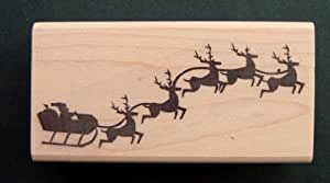 Santa Claus and reindeer rubber stamp WM P22