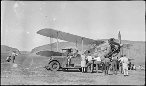 POSTER Small crowd truck examine Les Holden's de Havilland DH61 Giant Moth biplane airliner G-AUHW 'Canberra' field Alice Springs Northern Territory 7 April 1929. Australia Wall Art Print A3 replica