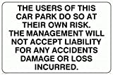 THE USERS OF THIS CAR PARK DO SO AT THEIR OWN RISK. THE MANAGEMENT WILL NOT ACCE - Mandatory Sign