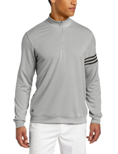 A TaylorMade - Adidas Golf Apparel with High mock - neck, hidden snap placket, snap closures, contrast adidas brand mark wearers right hip