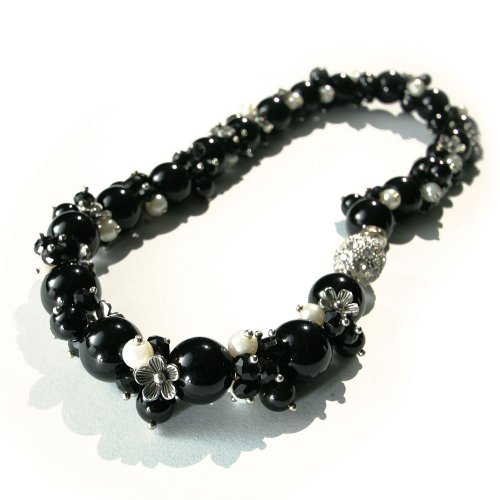 17 Inch Strand Necklace of Black Marble Beads with Pearl, Black Bead and Silver Flower Clusters and Has a Round Silver Magnetic Clasp Inlaid All Around with Diamantes.
