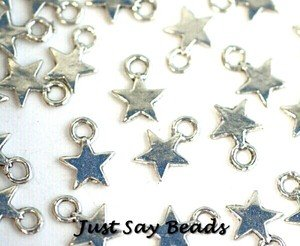 25 x Antique Silver Plated Star Charms with Jump Rings included for attachments. Universal use for Jewellery, Card Making and Scrap-booking. Check out our Fantastic wide range of Beads, Charms and Findings (Ref10A57)