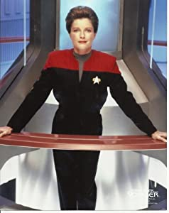Star Trek Voyager Kate Mulgrew as Captain Kathryn Janeway with Hair up leaning on barand Smile 8x10 Photo