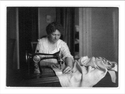 Historic Print (L): Woman Sewing With A Singer Sewing Machine