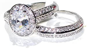 NEW IMPROVED! Never Tarnish 2.10ct Oval Cut World Class Lab Diamonds Engagement Wedding Set. 8.6mm Center Stone Ring & Double Row Clear Crystal Matching Band. Stamped 316. Steel 4.8gr Total Weight.