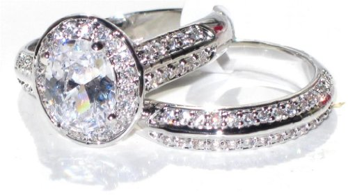 2.10ct Oval Cut World Class Lab Diamonds Crystal Outstanding Quality Engagement Wedding Set. 8.6mm Center Stone Ring & Double Row Clear Crystal Matching Band. White Gold Bonded. 4.8gr total weight.