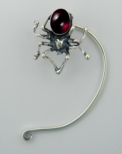 A Dramatic Spider Ear Wrap in Sterling Silver. Why Be Ordinary? Accented with Genuine Garnet. Fits Either Ear, Let us Know if you have a Preference.