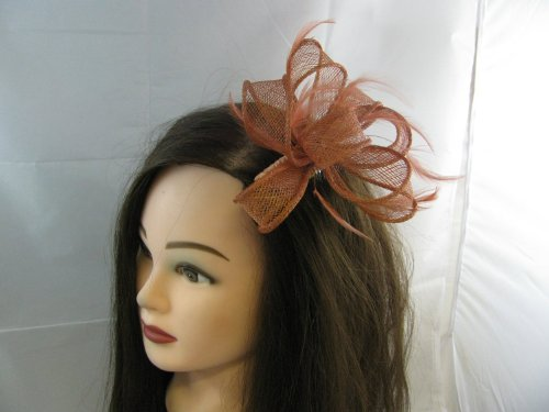 Delicate dark coral sinamay loops fascinator with feather tendrils set on clear comb. Ideal for a wedding, Ascot and any other special occasion.