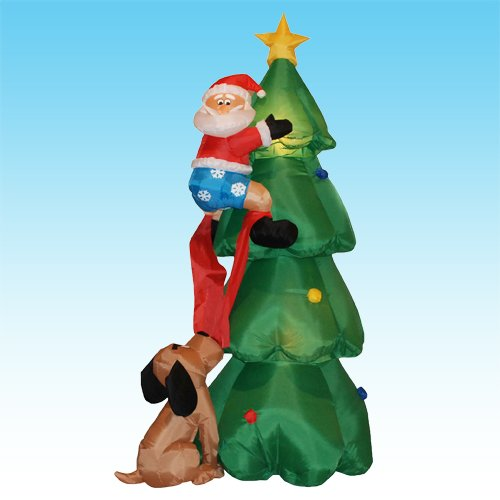Foot inflatable santa claus climbing on christmas tree