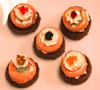Smoked Salmon Pinwheels 50 Piece Tray. Your Shipping Costs Go Down As You Buy More Appetizers. front-64764