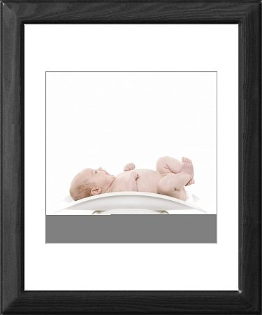 Framed Print of Baby being weighed from Science Photo Library