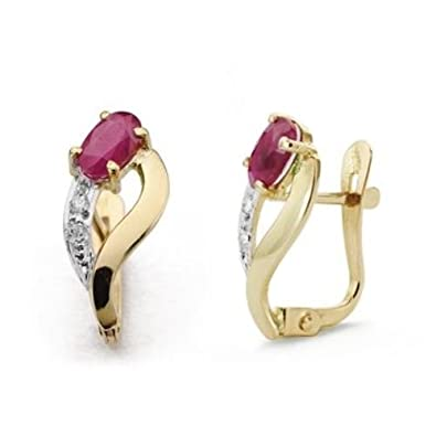 Bicolor 18K gold ruby earrings and cubic zirconia 15 × 6 mm.