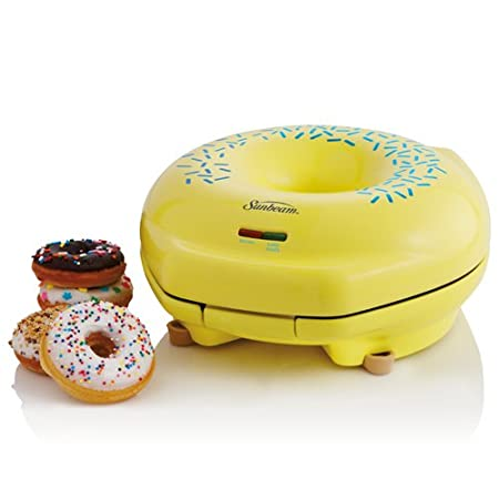 "Gather around and enjoy the warm, sugary goodness of a State Fair classic with help from this adorable Sunbeam donut maker. Shaped like an oversized version of the delicious treat, complete with rounded lid, center cutout, and printed ""sprinkles"", th..."