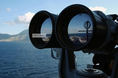 Photo A Us Navy (Usn) Lookout, Onboard The Usn Nimitz Class Aircraft Carrier, Uss Harry S Truman (Cvn 75), Uses A Mark 7 Big Eye Binoculars To Observe Shipping As The Uss Truman Transits Through The Straits Of Gibraltar Into The Atlantic Ocean (Aoc) On Th