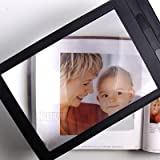 Large Full Page Magnifying sheet with black vinyl frame.This is a flexible plastic sheet which acts like a large magnifying glass. The quality of lense is determined by the groove density.This magnifier is high quality with over 3 grooves per mm. Len...
