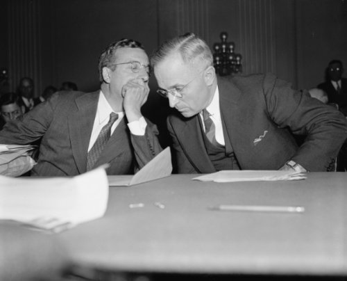 1938 photo Whispered advice. Washington, D.C., Oct. 14. Senator Harry Truman (right) of Missouri, wh