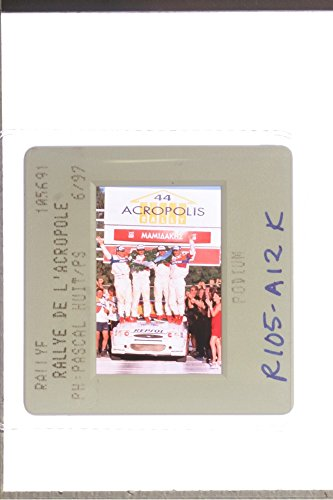 slides-photo-of-acropolis-rally-1997-winners-standing-on-the-car