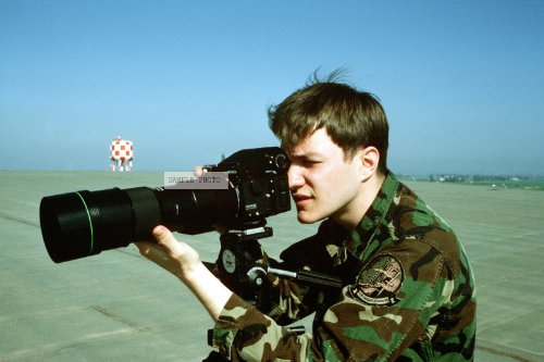 Photo Photographer'S Mate 3Rd Class Klein Uses A Tripod-Mounted Bronica Camera And Telephoto Lens To Document A Ceremony During The Maritime Patrol Aircraft Conference, 03/15/1991