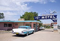 A Classic Car at the Blue Swallow on Route 66, Tucumcari, New Mexico - Iconic 16x20-inch Photographic Print by Carol M. Highsmith