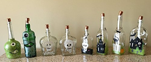 Tiki Torch - made from old Liquor bottles - 1-eyed monster, skulls, and spooky houses (Yukon Jack Whiskey compare prices)