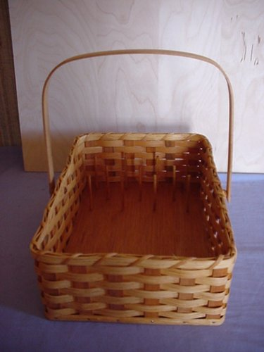 Amish Handmade Jewerly Basket or Thread Spool Sewing Basket. This Basket Has a Leather Loop At One End so You Can Hang It on the Wall and Drape Your Necklaces Over the Dowel Rod, or Place Your Rings Over Them to Hold Them in Place. Also Has a Moveable Handle. This Handmade Basket Can Also Be Used to Hold Your Spools of Thread in Place so They Can Ve Viewed and Organized By Color. Jewerly Basket Is Shown in Picture.....thread Spool Seweing Basket Will Contain Additonal Dowel Rods. Measures 10 1/4
