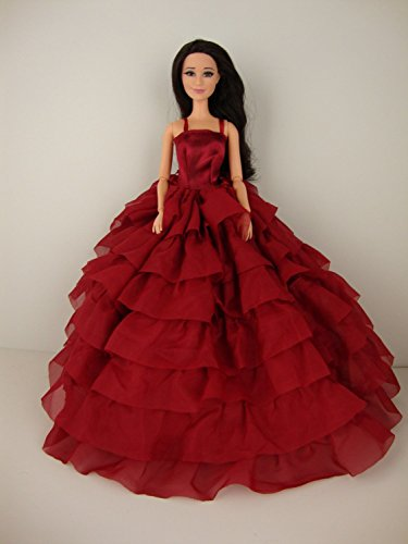 A Deep Red Gown with Layers of Ruffle Details Made to Fit the Barbie Doll