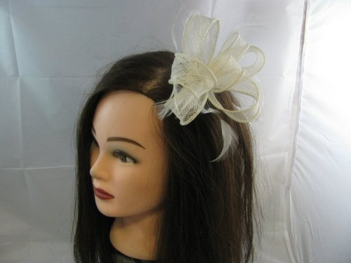 Delicate cream sinamay loops fascinator with feather tendrils set on clear comb. Ideal for a wedding, Ascot and any other special occasion.