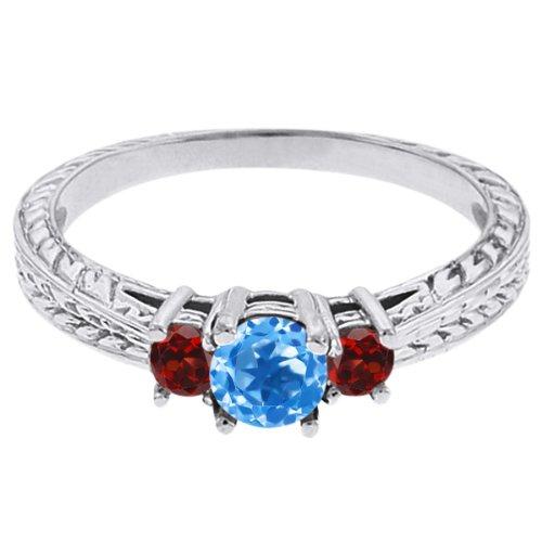 0.57 Ct Round Swiss Blue Topaz Red Garnet 18K White Gold 3-Stone Ring