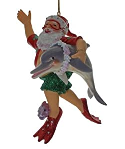 December Diamonds Santa & Friends Scuba Ornament!!! Santa is wearing a Scuba Mask & Snorkel. Wearing Red Scuba Fins.Holding a Dolphin.