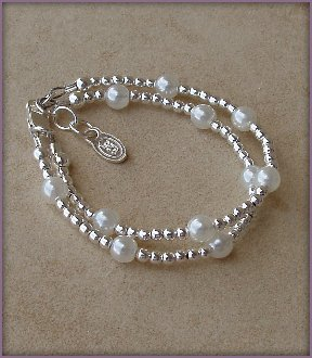 Ellie Sterling Silver Childrens Girls Bracelet Jewelry NEW! This unique double-stranded sterling silver bracelet with shimmering white Czech pearls is a gorgeous keepsake. This precious bracelet is perfect for christenings or baptisms too! Size Large 6-13 Years