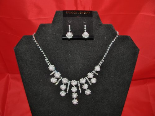 Silver effect necklace and earring set with white pearlised beads and diamonte stones.