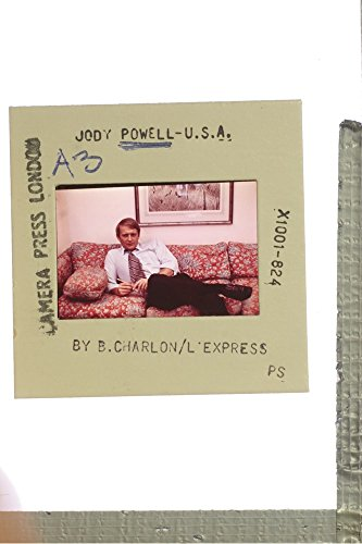 slides-photo-of-jody-powell-sitting-on-couch