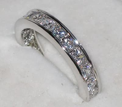 Womens Channel Set Swarovski ring. Outstanding quality eternity band. Rhodium electroplated. Will not tarnish.