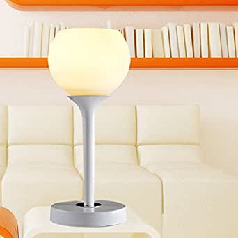 Modern Minimalist Stylish And Elegant Living Room With Decorative Upscale Glass Table Lamp