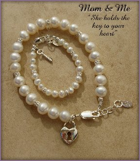 Mom and Me, Sterling Silver Bracelet Set for mother and daughter. This beautiful keepsake uses beautiful freshwater pearls accented with silver lock and key charms