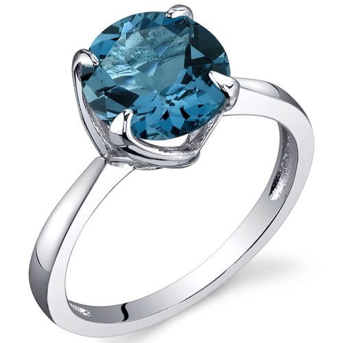 i just want an inexpensive one but i cant decide which or even if i want london or swiss - Blue Topaz Wedding Rings