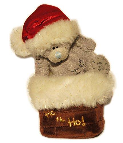 Me to You Teddy mit Weihnachtsmütze sitzt auf