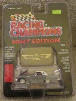 1956 GRAY FORD THUNDERBIRD -RACING CHAMPIONS MINT CONDITION DIE CAST EMBLEM & VEHICLE WITH DISPLAY STAND - 1